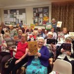 The ladies of Pound Green WI enjoying an evening in with some picture books!